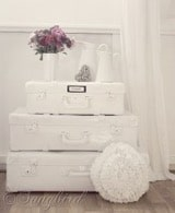 White stacked vintage suitcases