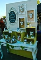 Vintage photo frames displaying products at a market stall