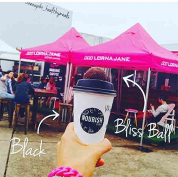 Lorna Jane market stall and takeaway coffee cup