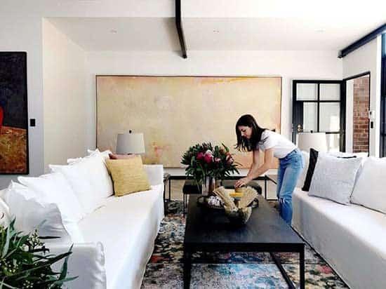 Interior Designer at work decorating a large living room