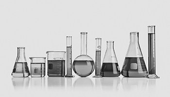 9 test tubes and beakers in a row