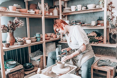 Pottery artist working in her workshop