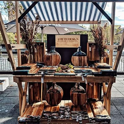 Market stall selling resin decorated wooden chopping boards