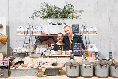 The owners of Raw Suds at their market stall
